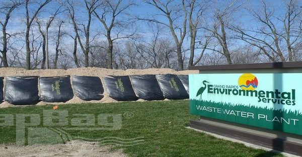 TrapBags set up as flood protection and prevention beside a wastewater plant