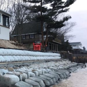 Retaining wall in front of homes