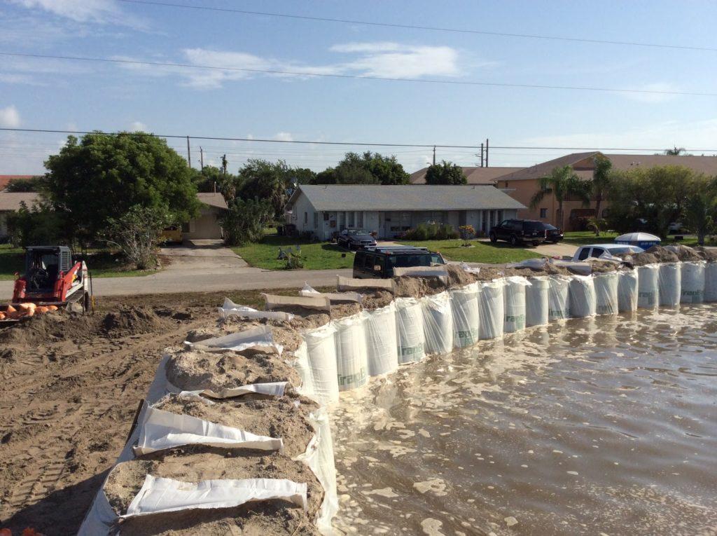 TrapBag flood barrier in residential neighborhood