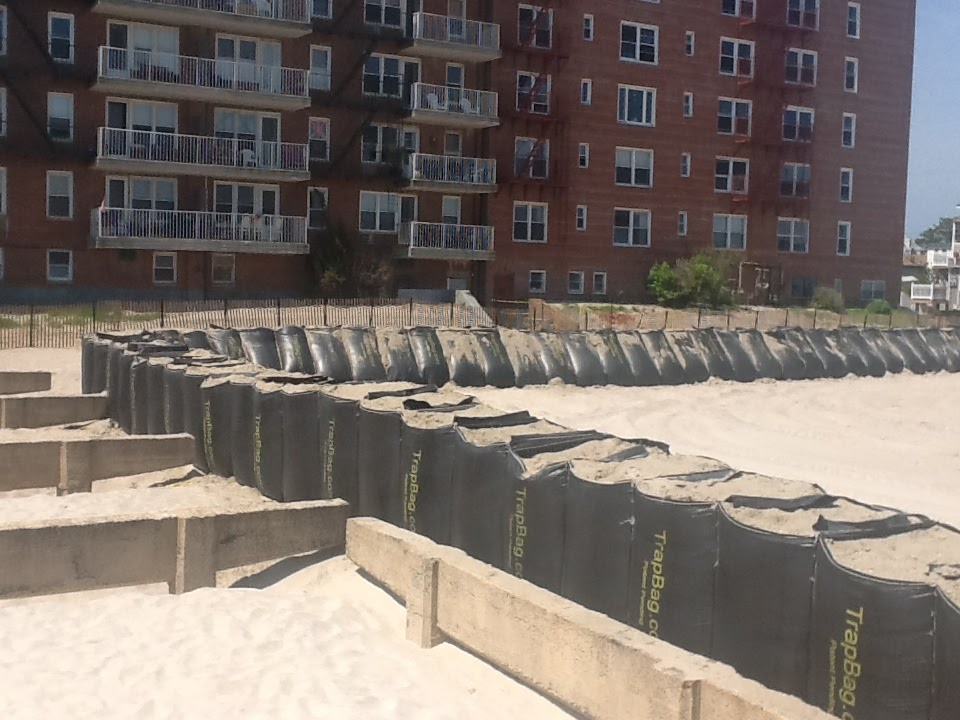 TrapBags used as barrier on beach to protect residential building