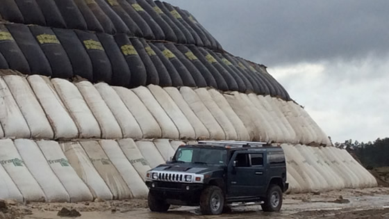 Hummer in front of a Cellular MSE Retaining Wall