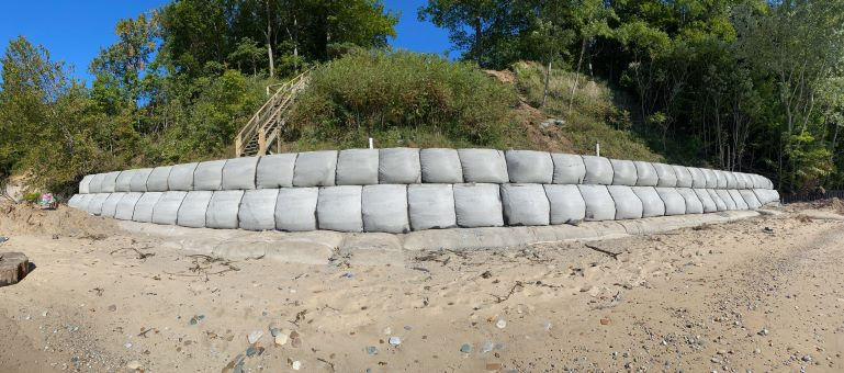 Seawall made out of TrapBag erosion control barriers