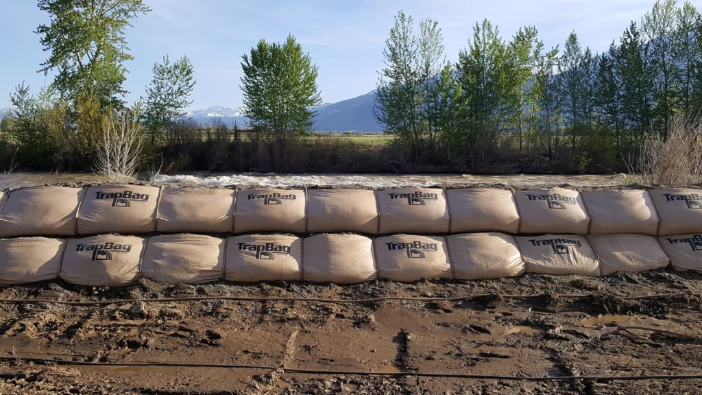 TrapBag levee system wall beside a river